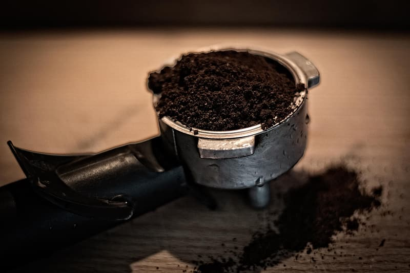 Shallow focus photography of gray and black coffee filter