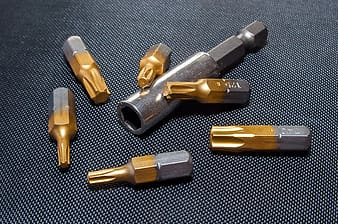 Silver and brass metal handheld tool