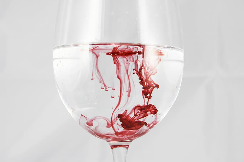 Wine glass filled with liquids
