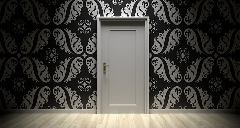 White wooden door on black and white floral wall
