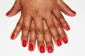 Red nail polished manicure