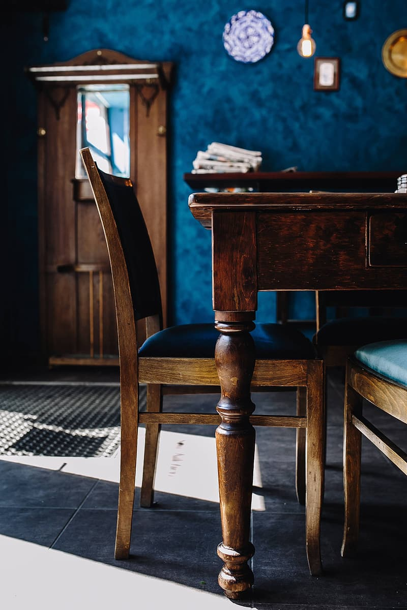 Brown wooden chair beside brown wooden table