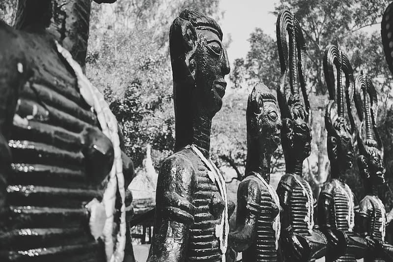 Grayscale photography of ancient statues