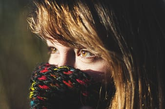Woman with brown hair covering her face