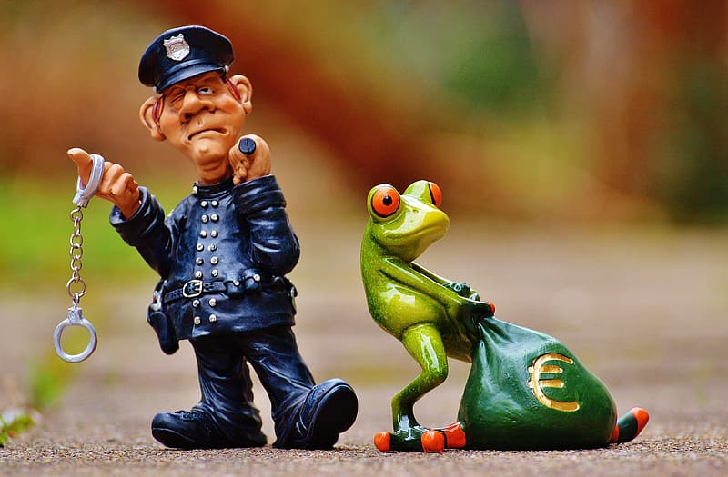 Close-up photo of frog and policeman character figurines