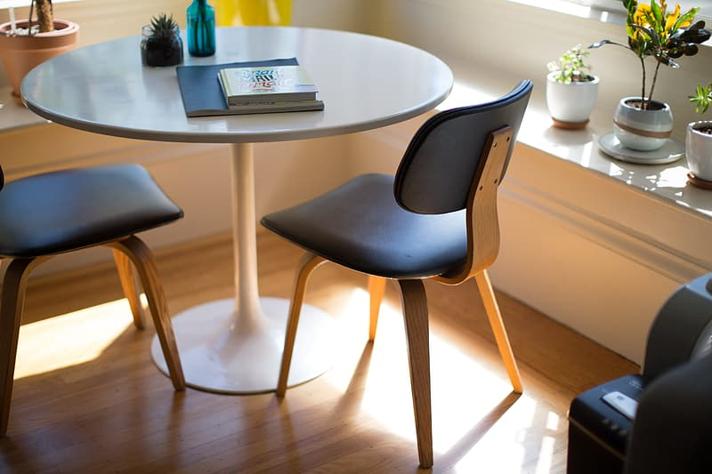 Oval white wooden dining table with chairs