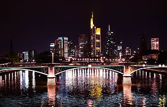 Lighted building and bridge cityscape
