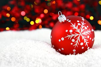 Selective photo of red and white Christmas bauble