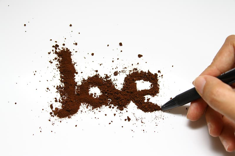 Person writing love on paper