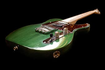 Green and brown electric guitar