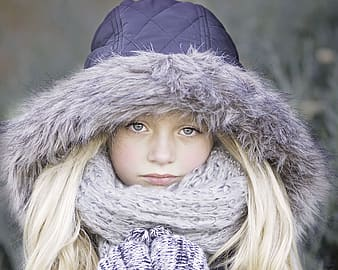 Girl wearing scarf and fur-lined hoodie