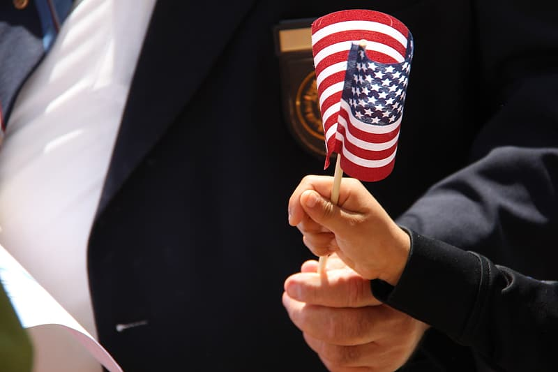 Person holding American flaglet