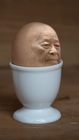 Egg with face in white cup