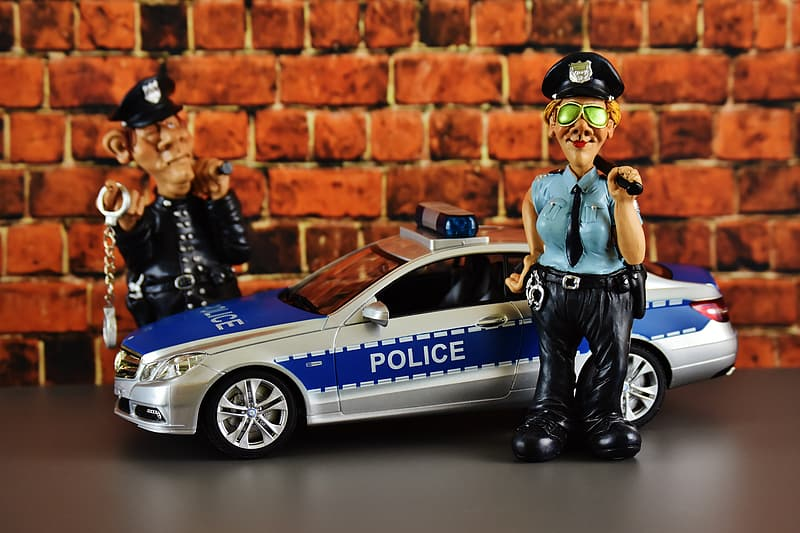 White and blue police car and two policemen toys