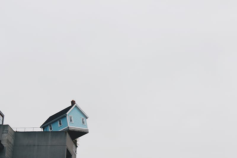 Teal and black wooden house on building
