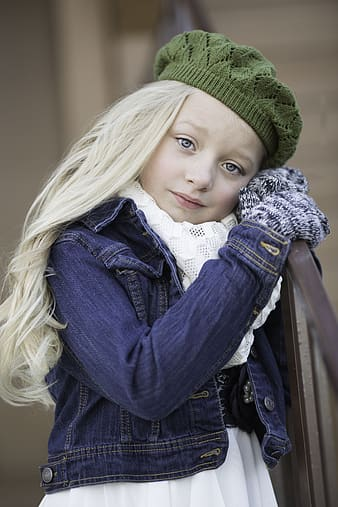 Girl in blue denim jacket and green knit cap