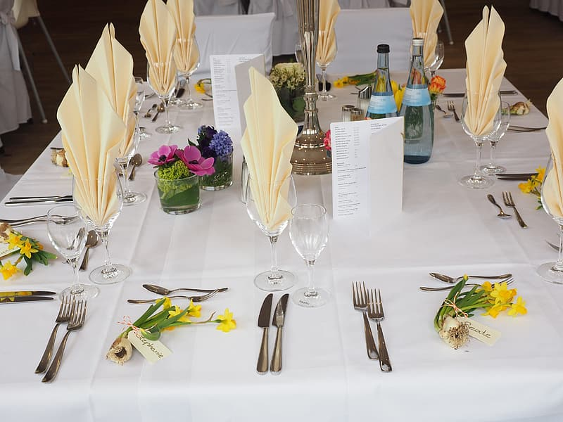 Table setting with flowers and bottle on table