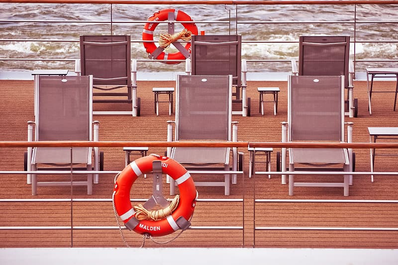 Brown and white loungers on ship