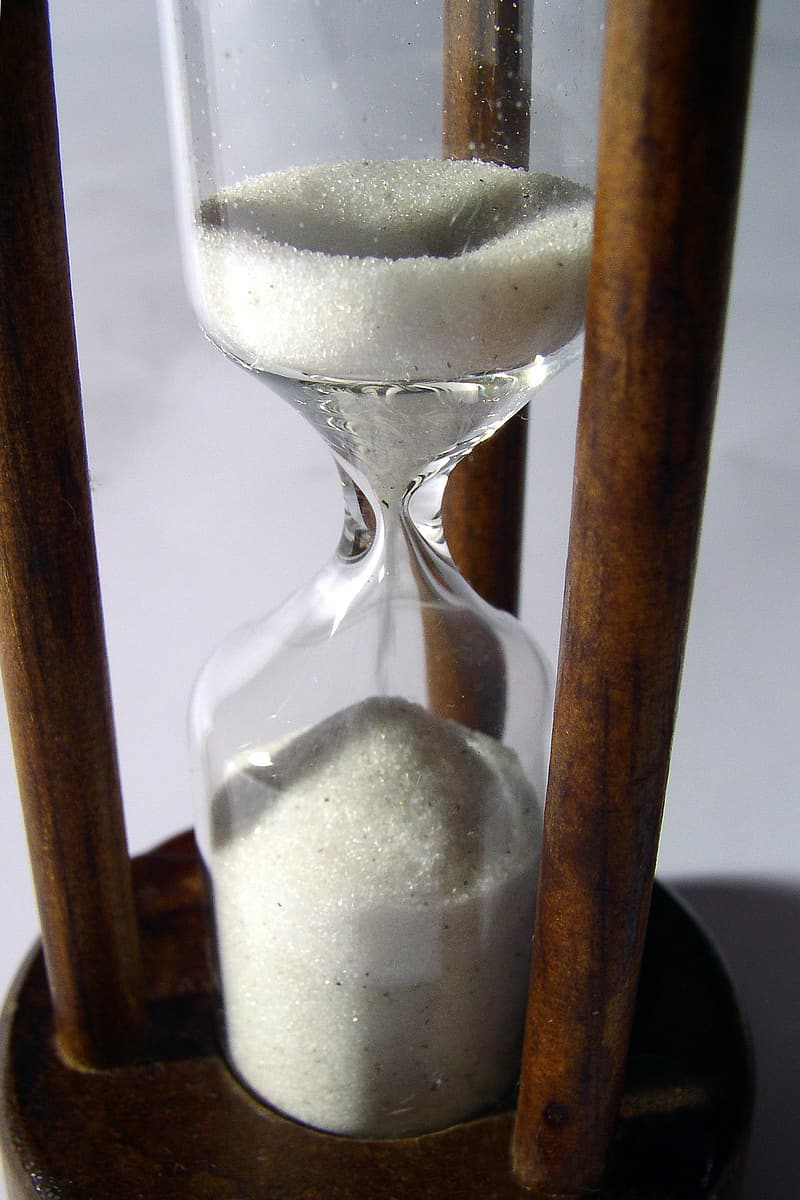 Hour glass with brown wooden frame