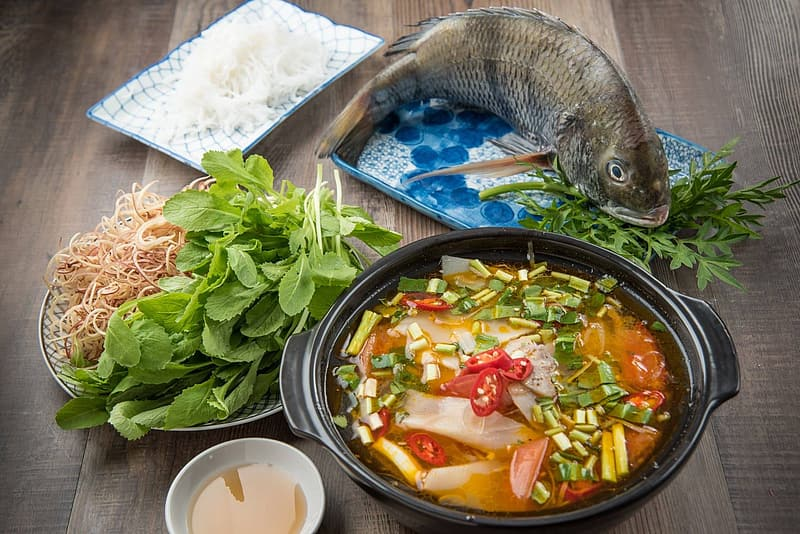 Fish with vegetable and sauce dish served on casserole
