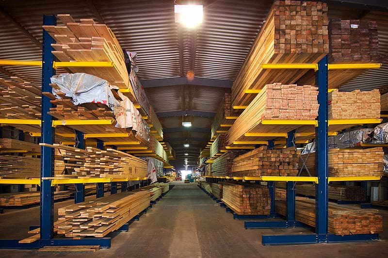 Storage warehouse full of wooden planks and bars