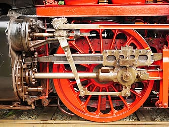 Red and black train wheel