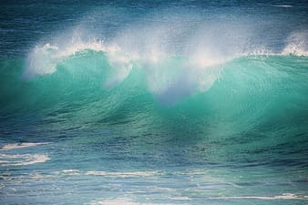 Green and white ocean waves