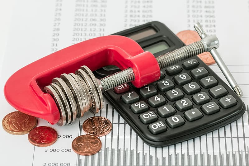 Red and gray clamp tool and desk calculatior