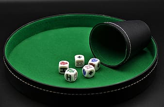 White dice on green table