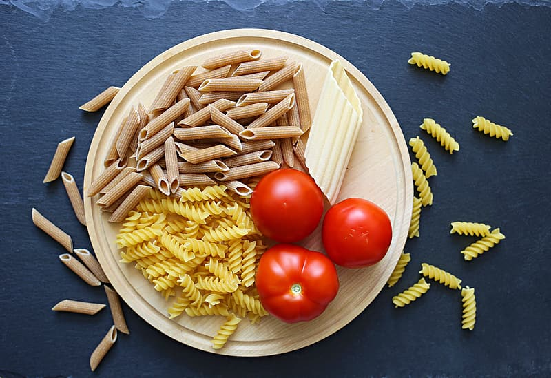 Assorted pastas and tomatoes on tray