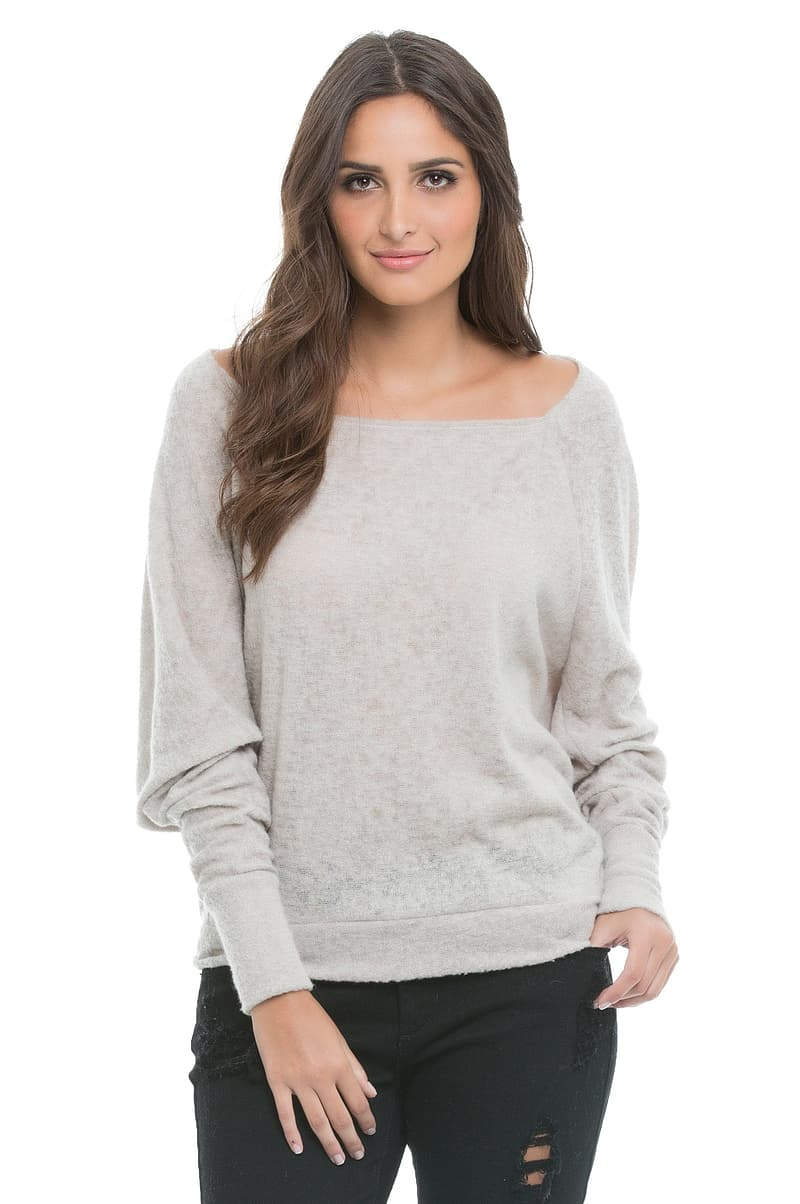 Woman wearing gray scoop-neck top and black bottoms