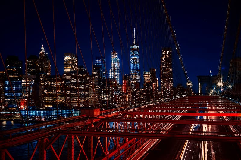 Time lapse and light streaks photo of cars on the bridge with high rise buildings as background
