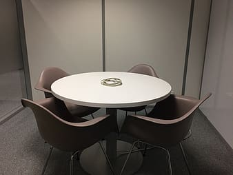 Round white wooden table and chairs