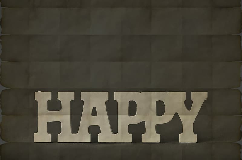 Happy text on gray backgroud