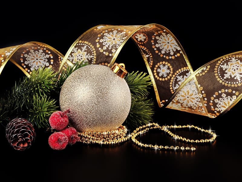 Gray Christmas bauble, brown pine cone, and gold-colored ribbon