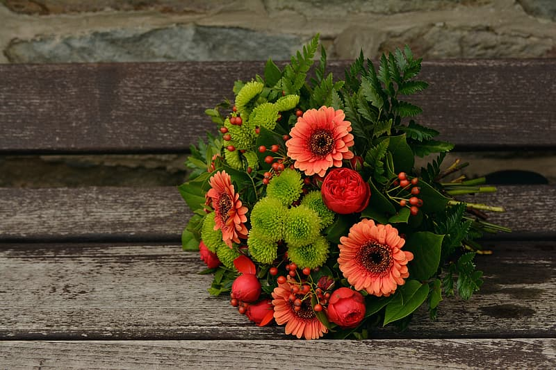 Red and green petaled flower bouquet