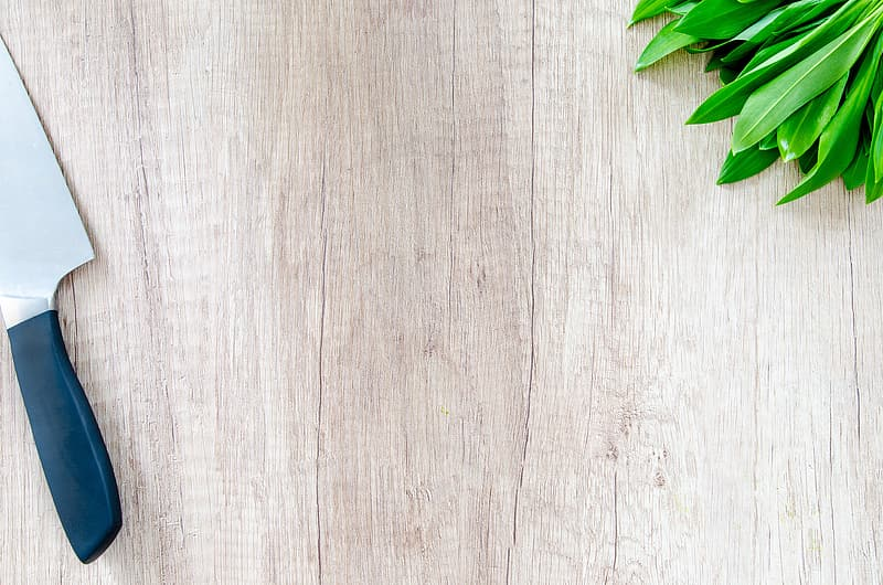 Green leaves on white wooden surface