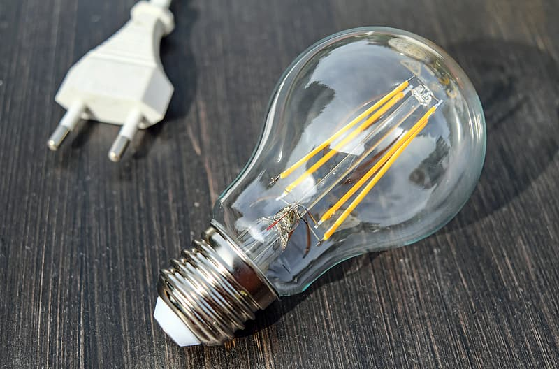 Clear and gray light bulb and white power cord
