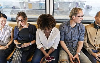 Group of people sitting inside train