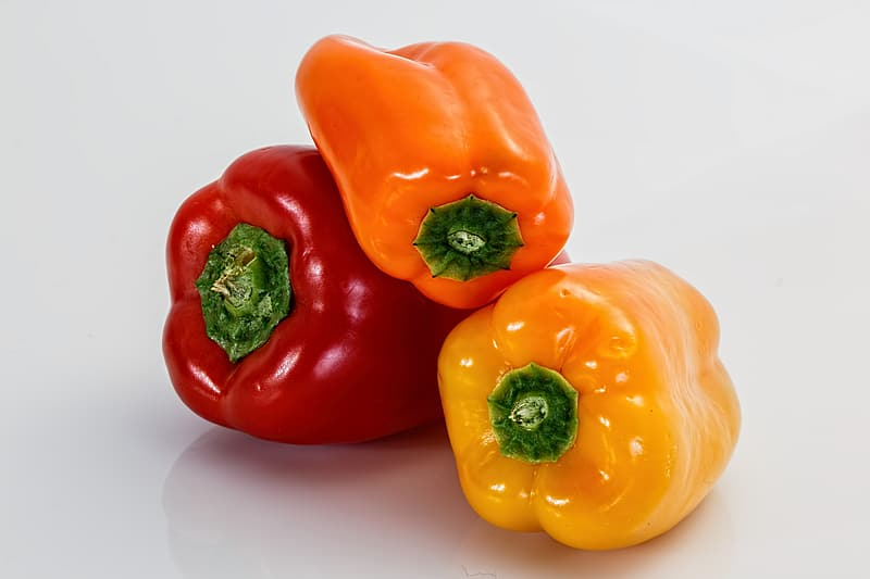 Three red, orange, and yellow bell peppers