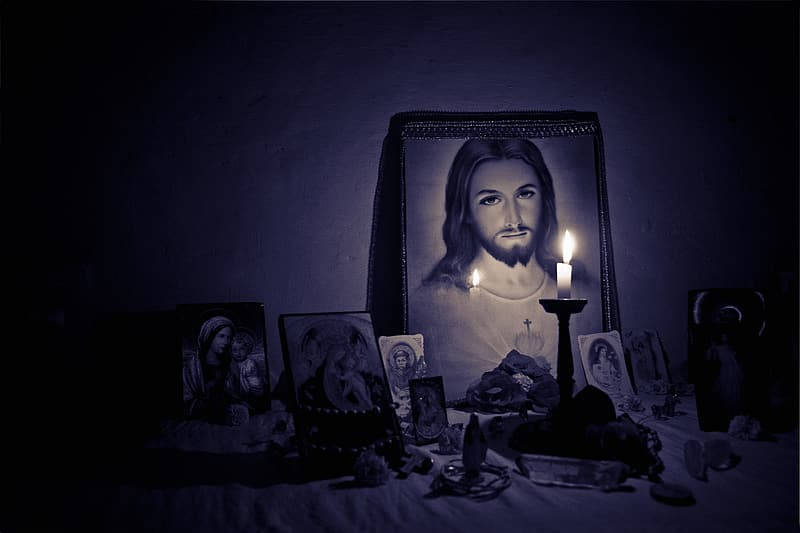 Taper candle behind Jesus Christ photo