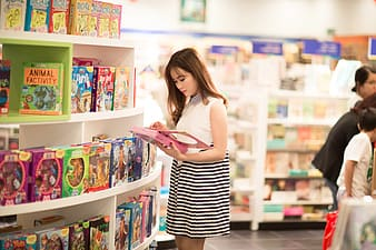 Woman holding book inside store