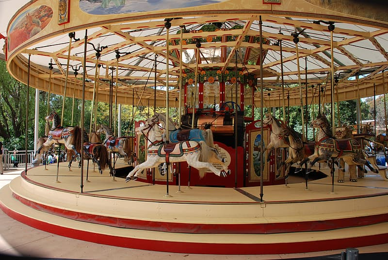 Beige and red horse carousel