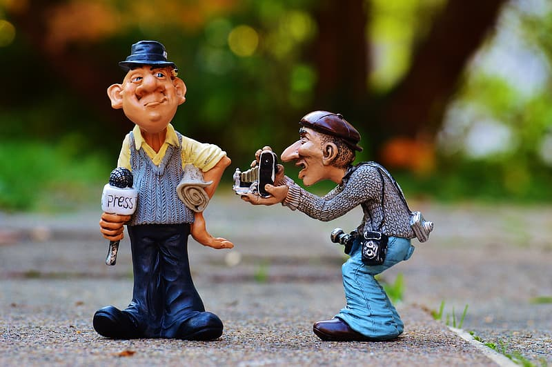 Shallow focus photography of two men plastic toys