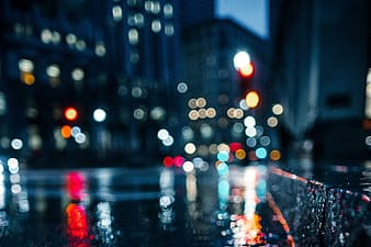 A wet city street at night