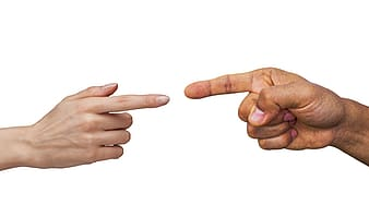 Persons hand doing thumbs up sign