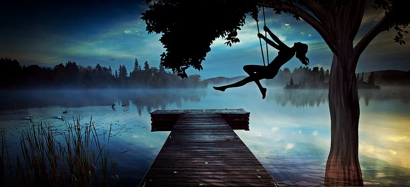 Silhouette of a woman riding on swing at night