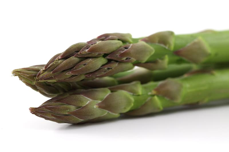 Close view of asparagus on white surface