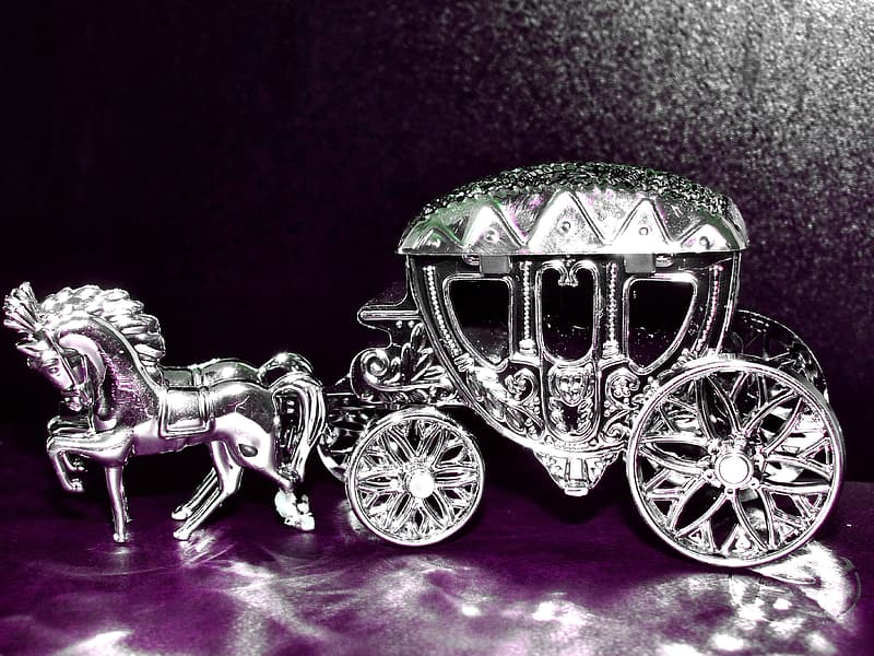 Silver-colored horse carriage figurine