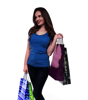 Woman holding paper bags facing sideways